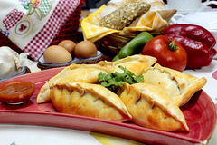 Empanadas argentinas. Argentinian style empanadas, filled with chicken, meat, eggs and olives, or tuna. Traditional cuisine, spanish heritage Royalty Free Stock Photos
