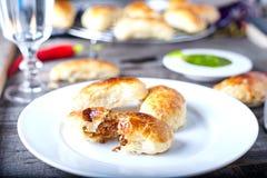 Empanadas - Argentine roasted meat pies Stock Photo
