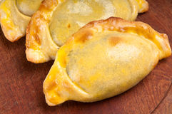 Empanadas over wood table Royalty Free Stock Photography