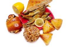 Empanadas, pescados y limón Foto de archivo