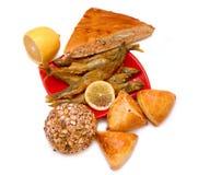 Empanadas, pescados y limón Imagenes de archivo