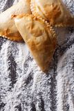 Empanadas on a table with flour spills. vertical top view Royalty Free Stock Photography