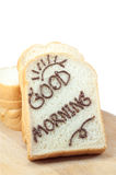 Empane la rebanada con el chocolate y mañana de la palabra la buena Imagen de archivo libre de regalías