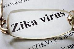 Empapele con el virus y los vidrios del zika de las palabras Foto de archivo libre de regalías