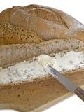Emparedado del pan marrón que unta con mantequilla Imagen de archivo