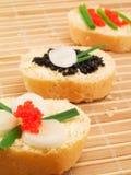 Emparedados con el caviar Foto de archivo