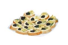 Emparedados con el caviar negro Foto de archivo