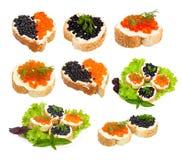 Emparedados con el caviar negro y rojo Imágenes de archivo libres de regalías