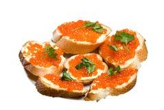 Emparedados con el caviar rojo. Imágenes de archivo libres de regalías