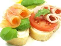 Emparedados con los salmones, el jamón y el queso Imagen de archivo libre de regalías