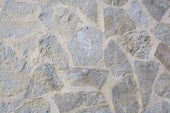 Emparede con el fondo nervioso de las rocas Imagen de archivo