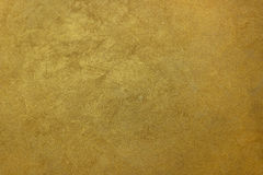 Emparede el fondo de seda de la pintura del efecto del oro anaranjado de la textura Imagen de archivo libre de regalías