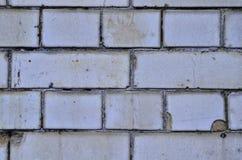 Emparede el modelo retro blanco del fondo del edificio de ladrillo coloreado texturizado Imagen de archivo