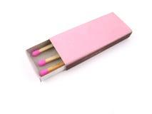 Emparejamientos de madera rosados en caja de fósforos Fotos de archivo libres de regalías
