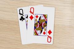 Emparelhe das rainhas - casino que joga cartões do pôquer fotografia de stock royalty free