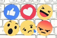 Empathetic Emoji Reactions on computer keyboard. Kiev, Ukraine - February 07, 2017: Facebook like button 6 Empathetic Emoji Reactions printed on paper and placed royalty free stock photography