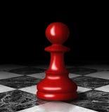Empeño rojo del ajedrez en el tablero de ajedrez de mármol. Fotografía de archivo