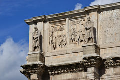 Emperor Constantine meets the barbarian leaders and prisoners. Detail from Arch of Constantine attic with the emperor among roman soldiers and two statues of Stock Photography