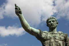 Emperor Gaius Augustus statue. Statue of Roman Emperor Gaius Julius Caesar Augustus with blue sky and cloudscape background Royalty Free Stock Photography