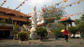 Emperor Jade Temple. Unidentified people visit Emperor Jade Temple Ngoc Hoang. Emperor Jade Temple was built by the Chinese community in 1910