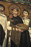 Emperor Justinian. UNESCO listed byzantine mosaic of the Emperor Justinian flanked by archbishop Maximian. from the ancient basilica of St Vitalis, Ravenna Stock Photography
