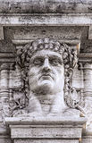 Emperor Nero Head Statue. A statue relief of emperor Nero's head on the gateway entrance to the park that contains the ruins of his golden palace at domus aurea Royalty Free Stock Photography