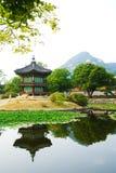 Emperor palace at Seoul. South Korea. Lake. Mountain. Reflections stock image