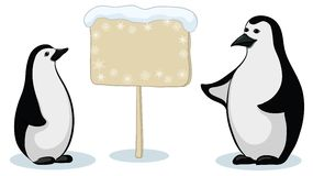 Emperor penguins with sign Stock Photos