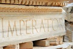 Emperor word on Roman ruins, Libya royalty free stock photos