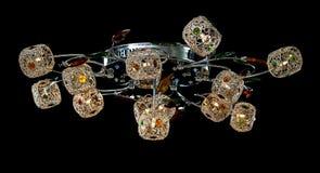Empfindlicher Leuchter von den Farbblumenlampen lokalisiert auf Schwarzem Stockfotos