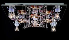 Empfindlicher Leuchter von den Farbblumenlampen lokalisiert auf Schwarzem Stockfotografie