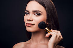 Emphasizing her cheekbones. Stock Images