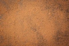 Empilez la poudre de cacao, le fond d'un brun sec de cacao de poudre, tas de Photos stock