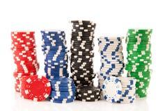 Empilha microplaquetas de póquer coloridas Imagem de Stock Royalty Free
