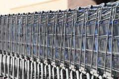 Empilhando o carrinho de compras em seguido Fotos de Stock Royalty Free