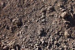 empilhe o close up marrom cinzento escavado do solo e da sujeira Imagem de Stock Royalty Free