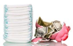 Empilhe os tecidos, o mealheiro quebrado e o dinheiro isolados no branco Fotos de Stock