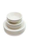Empilhe placas de jantar bege, placas de sopa e saucers fotografia de stock royalty free