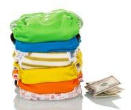 Empilhe tecidos modernos e o dinheiro eco-amigáveis isolados no branco Foto de Stock Royalty Free