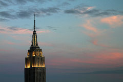 Empire at Dusk. The Empire State Building seems to stand alone against a pink sky at dusk over New York City stock photography
