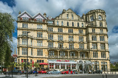 Empire Hotel in Bath, Somerset, England. BATH, ENGLAND - JULY 28: the Empire Hotel, by architect Major Charles Edward Davis for the hotelier Alfred Holland  on Royalty Free Stock Image