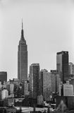 Empire State Black and White. NEW YORK-AUGUST 10-A black and white film photograph of the Empire State Building and New York City Skyline on August 10 2014 Royalty Free Stock Photography