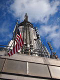 Empire State Building. The top of the empire state building with an american flag Royalty Free Stock Image