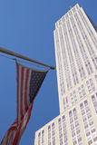 Empire State Building with American flag. NEW YORK - SEPTEMBER 21 : Empire state building facade with American flag on September 21, 2012 in NYC. It stood as the stock photos