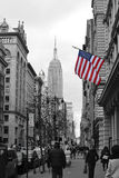 Empire State Building B&W. The Empire State Building in black and white with the American flag in color Royalty Free Stock Images