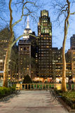 Empire State building behind trees Stock Images