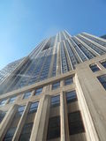 Empire State Building from Below. View of the Empire State Building from the foot of the building in the middle of the street Stock Photos