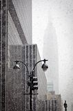 Empire State building in blizzard stock images