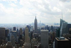 Empire State. Building centered and Manhattan behind Stock Images