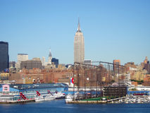 Empire State Building and Hudson river dock Royalty Free Stock Photos